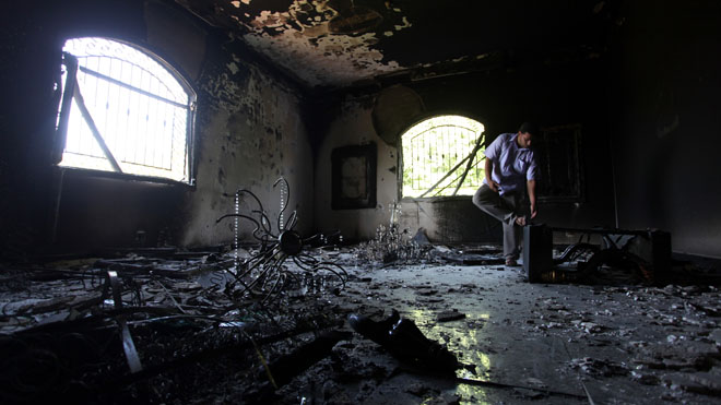 In this Sept. 13, 2012 file photo, a Libyan man investigates the inside of the U.S. Consulate after the attack that killed four Americans. (AP)